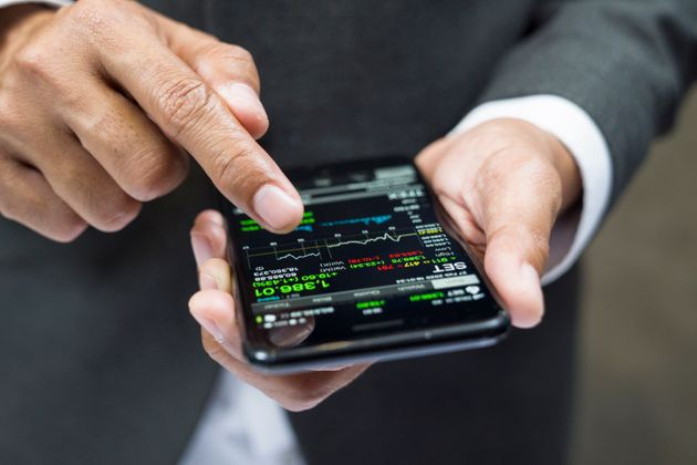 Manager buying cryptocurrency through mobile phone