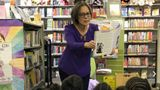 "The author at Piedmont Avenue Branch Library in Oakland, California, showing students from Piedmont Elementary School a photo of the ""real Danny"" after reading them her children's book on Oct. 19, 2017."