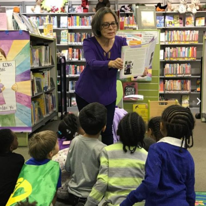 The author at Piedmont Avenue Branch Library in Oakland, California, showing students from Piedmont Elementary School a photo