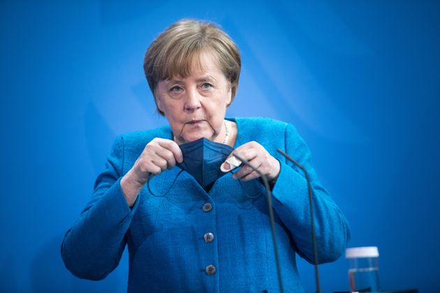 BERLIN, GERMANY - MAY 08: German Chancellor Angela Merkel puts on her protective face mask after speaking...