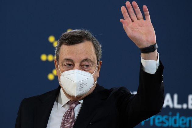 Italy's Prime Minister Mario Draghi arrives to give a press conference during the European Social Summit...