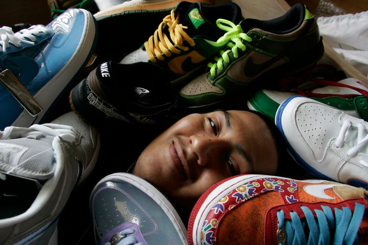 Cesar Vasquez, who owns 300 pairs of limited-edition sneakers, is photographed at his Los Angeles home with some of them. He often camps outside sneaker boutiques to get rare shoes, which he then resells on eBay for triple the price.