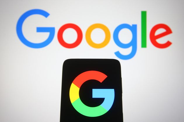 UKRAINE - 2021/04/29: In this photo illustration, a Google logo seen displayed on a smartphone and a...
