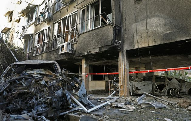 A picture shoos the damages in a residential building after a rocket attack from the Hamas-controlled...