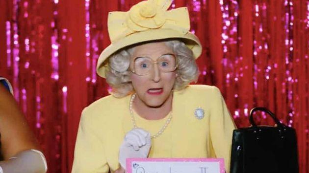 Anita Wig'lit in character as Queen Elizabeth
