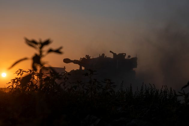 A truck carries an Israeli artillery unit to a position in the Israeli Gaza border, Thursday, May 13,...