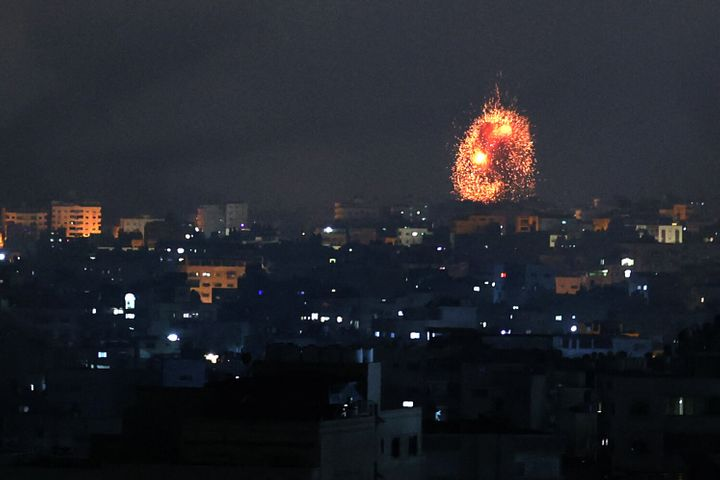 An explosion lights the sky following an Israeli airstrike on Beit Lahia in the northern Gaza Strip on May 14, 2021.
