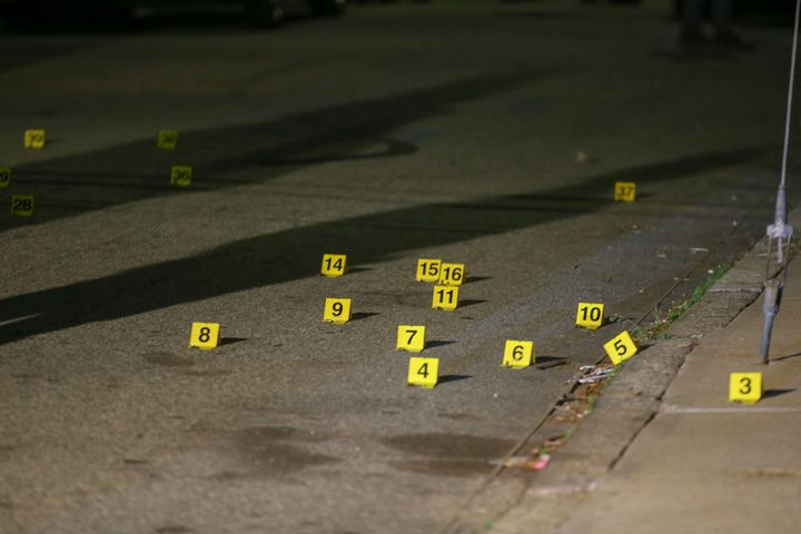 Evidence markers line the street outside a house on Carolina Avenue after a shooting, late Thursday, May 13, 2021, in Provide