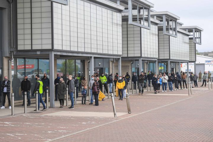 Large queues outside a vaccine centre Elgin, Moray, Scotland.
