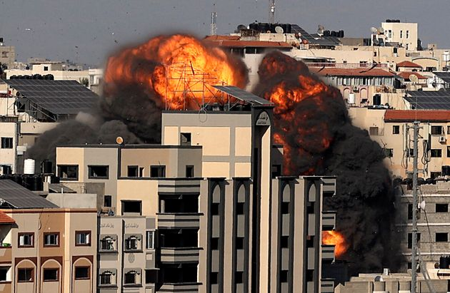 TOPSHOT - A picture shows the explosion after an Israeli strike targeted a building in Gaza City on May...