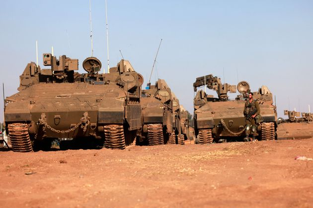 An Israeli soldier is pictured from a position in southern Israel along the border with the Gaza Strip...