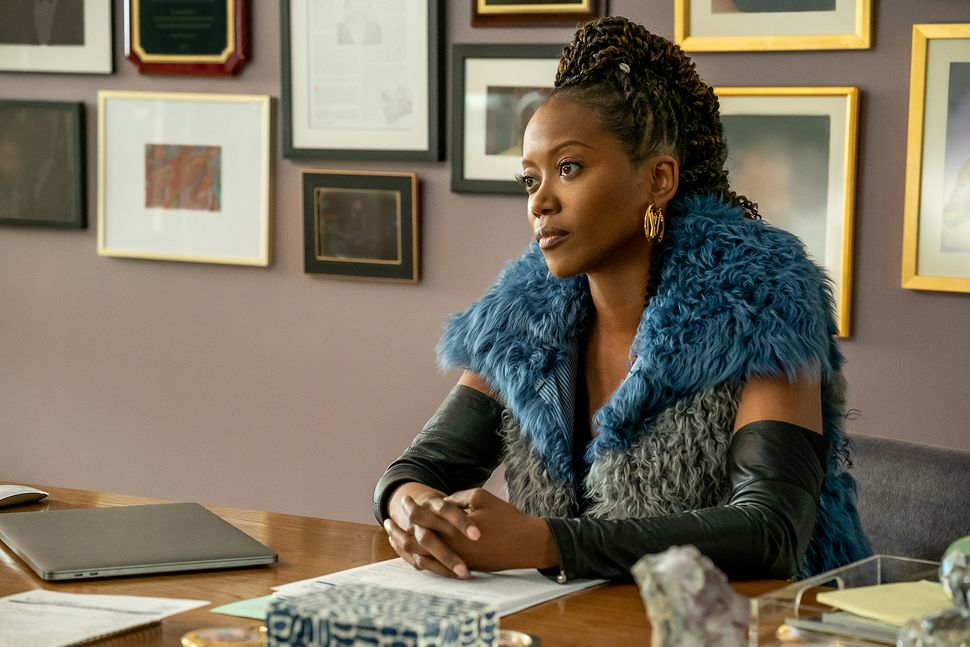 """Erika Alexander portrays an impeccably dressed boss on """"Run The World."""""""