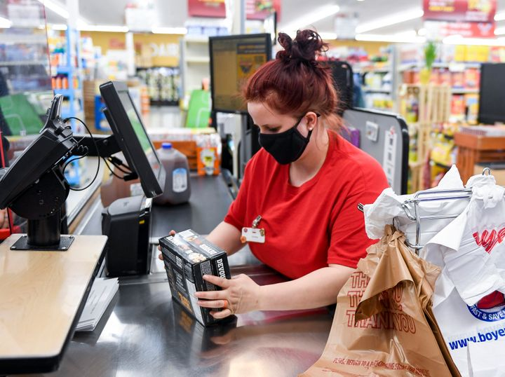 Several grocers said Friday that they will reevaluate their mask policies for customers in light of the new CDC guidance.
