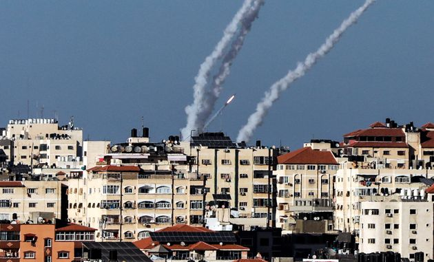 Some from rockets fired towards Israel by Palestinian Islamist movement Hamas billows in the air in Gaza...