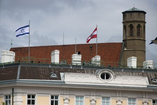 The national flag of Israel is seen atop the federal chancellery in Vienna, Austria May 15, 2021. REUTERS/Lisi