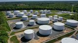 WOODBINE, MD - MAY 13: In an aerial view, fuel holding tanks are seen at Colonial Pipeline's Dorsey Junction Station on May 13, 2021 in Washington, DC. The Colonial Pipeline has returned to operations following a cyberattack that disrupted gas supply for the eastern U.S. for days. (Photo by Drew Angerer/Getty Images)