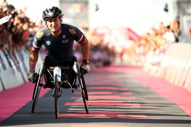 CERVIA, ITALY - SEPTEMBER 21: Alex Zanardi of Italy crosses the finish line in IRONMAN Italy on September...