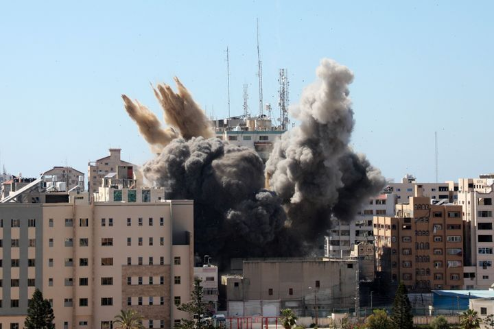 A thick column of smoke rises from the Jala Tower as it is destroyed in an Israeli airstrike in Gaza City on Saturday.