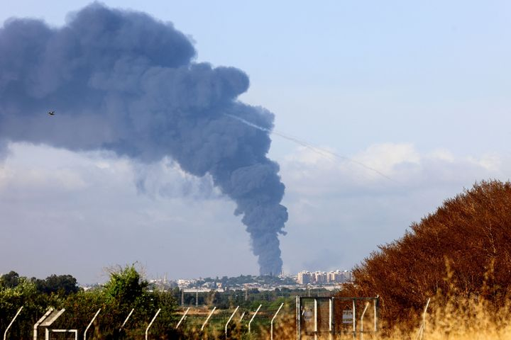 A picture taken from Yad Mordecahi in southern Israel shows a thick column of smoke billowing in the Gaza Strip following Isr
