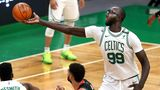 BOSTON - APRIL 2: Boston Celtics center Tacko Fall (99) grabs a loose ball out of the air at arms length in the 4th quarter. The Boston Celtics host the Houston Rockets in a regular season NBA game at TD Garden in Boston on April 2, 2021. (Photo by John Tlumacki/The Boston Globe via Getty Images)
