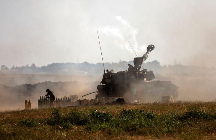 An Israeli artillery unit fires toward targets in the Gaza Strip, at the Israeli-Gaza border, Sunday, May 16, 2021. (AP Photo