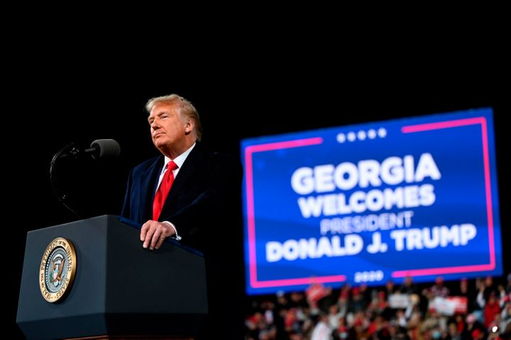 Donald Trump speaks at a rally to support Republican Senate candidates at Valdosta Regional Airport in Valdosta, Georgia on D