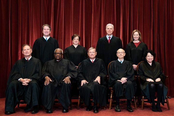 Seated from left: Associate Justice Samuel Alito, Associate Justice Clarence Thomas, Chief Justice John Roberts, Associate Ju