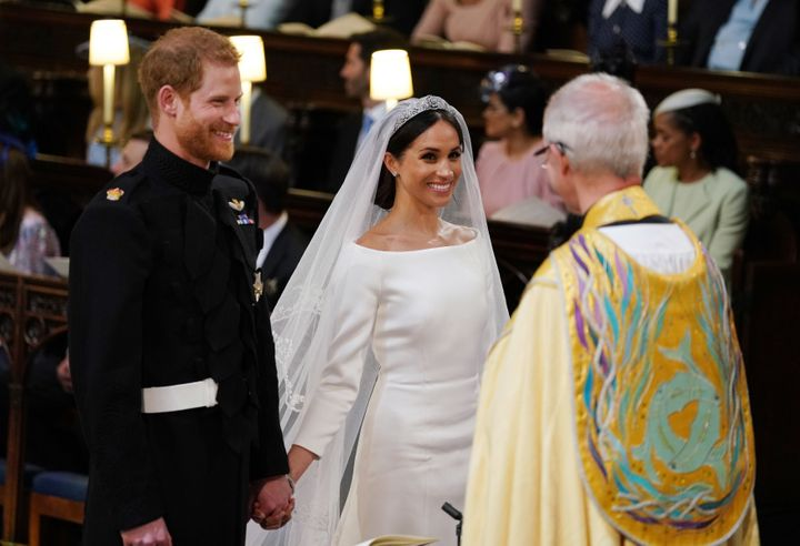 Prince Harry and Meghan Markle during their wedding service, conducted by the Archbishop of Canterbury Justin Welby in St Geo