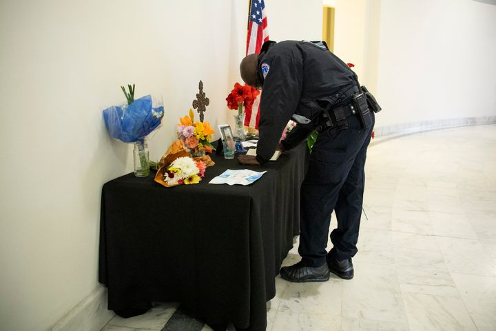 A U.S. Capitol Police officer signs a memorial book for Capitol Police Officer Howard Liebengood on Jan. 12, 2021. Liebengood