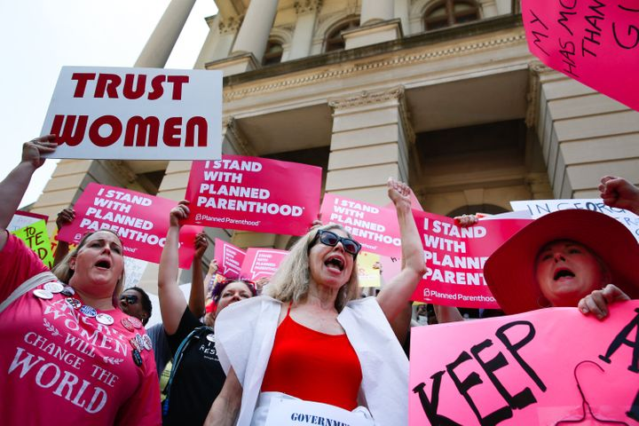 People in Atlanta protest against Georgia's six-week abortion ban in 2019.