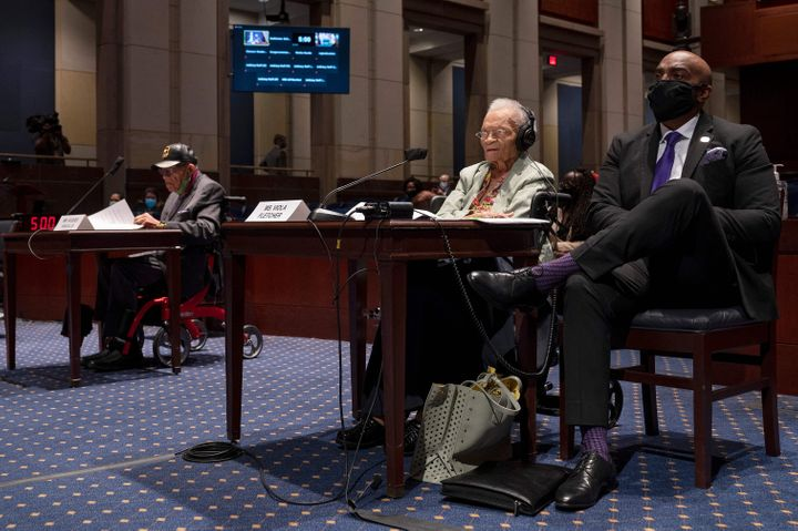 """Hughes Van Ellis (left), a Tulsa race massacre survivor and World War II veteran, and Viola Fletcher (middle), the oldest living survivor of the massacre, testify before the House Civil Rights and Civil Liberties Subcommittee hearing on """"Continuing Injustice: The Centennial of the Tulsa-Greenwood Race Massacre"""" in Washington, D.C., on May 19. Credit:JIM WATSON/AFP via Getty Images"""