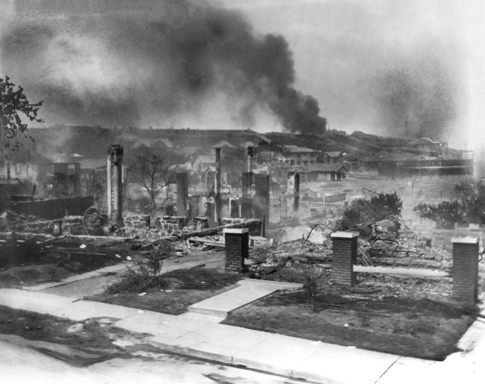 The ruins of African Americans' homes smolder in June 1921 following the Tulsa race massacre. Credit:Alvin C. Krupnick Co./Universal History Archive/Universal Images Group via Getty Images