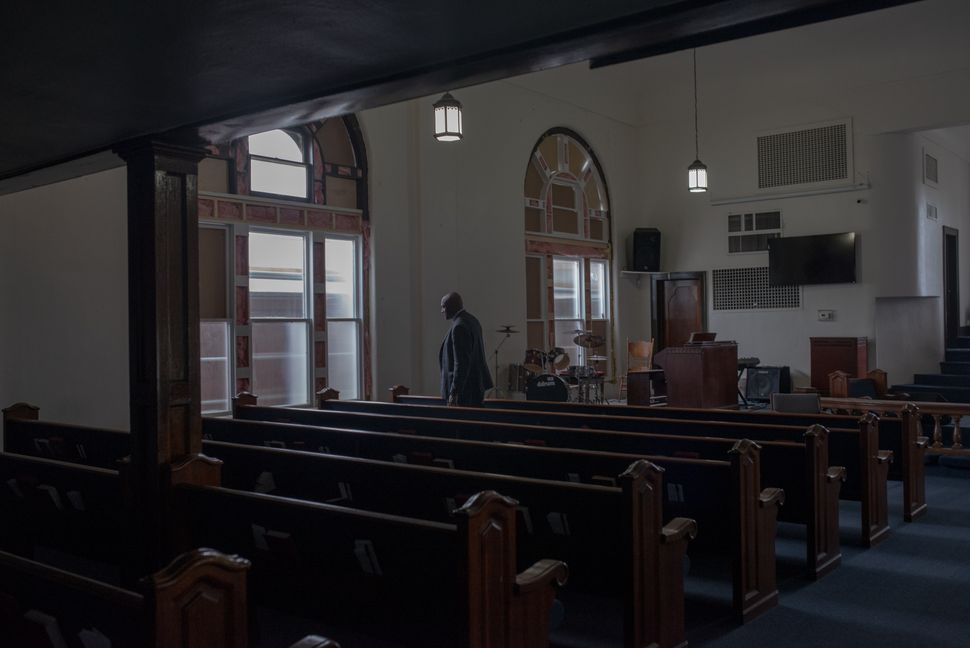 Rev. Dr. Robert Turner in the Vernon AME Church in the Greenwood district.