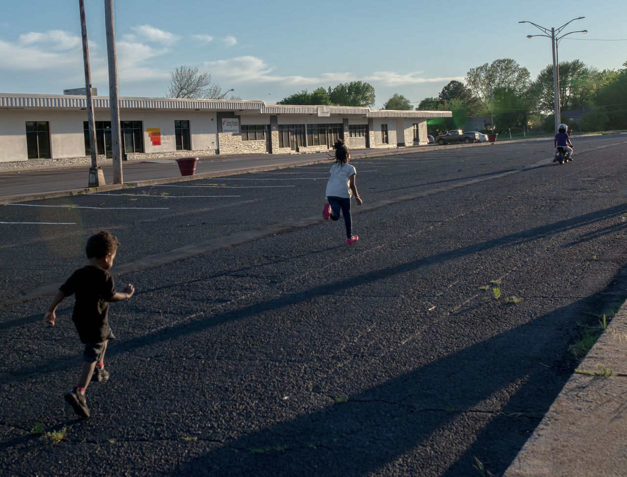 Children play in front of the Gibbs Shopping Center in North Tulsa.