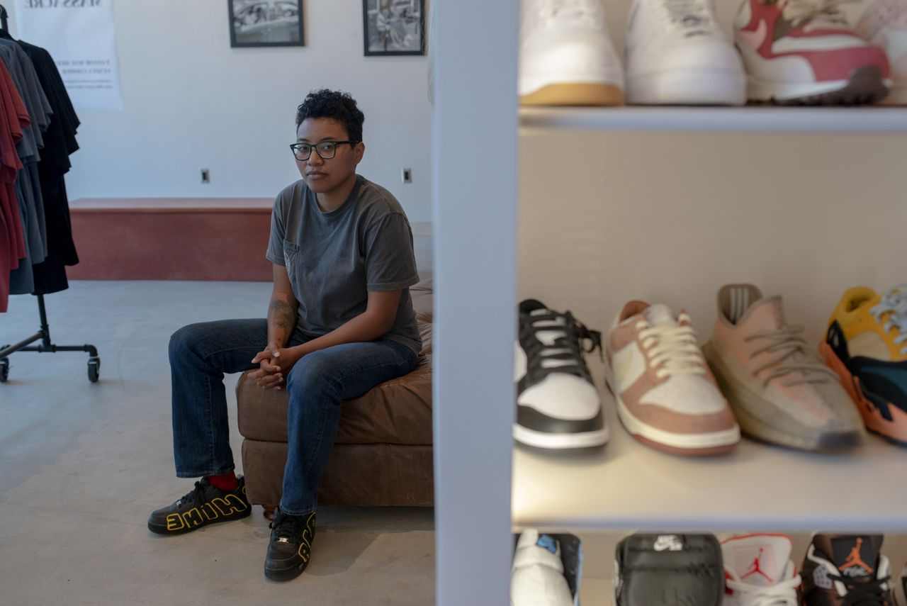Venita Cooper poses in her store Silhouette, a high-end sneaker spot in the heart of Greenwood.