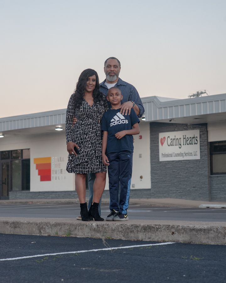 Tracy Gibbs and her family in front of their generationally owned shopping center in North Tulsa.