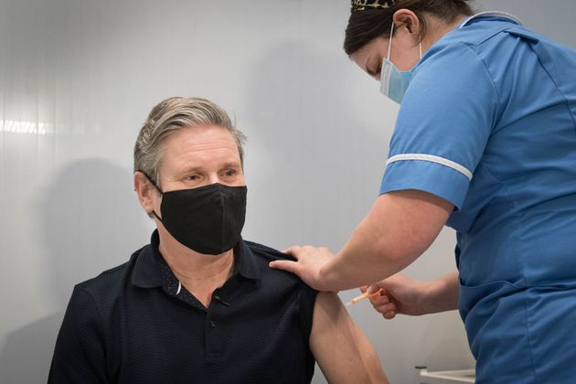 Keir Starmer receives his first dose of the AstraZeneca coronavirus vaccine from midwife, Emily Malden...