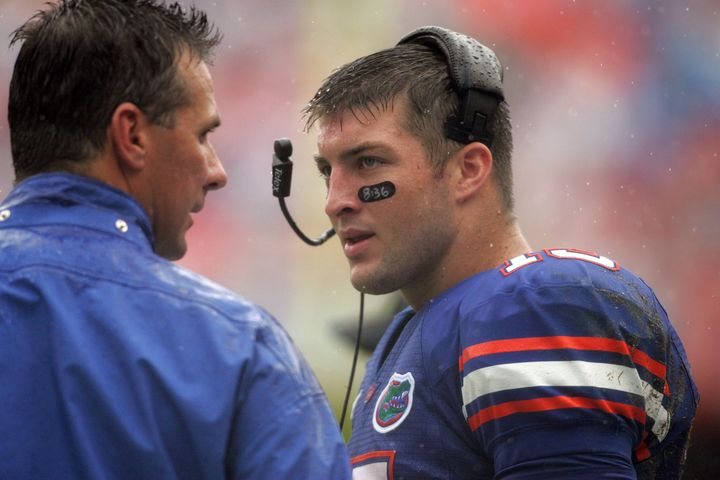Florida coach Urban Meyer chats with quarterback Tim Tebow on the sidelines in 2009.