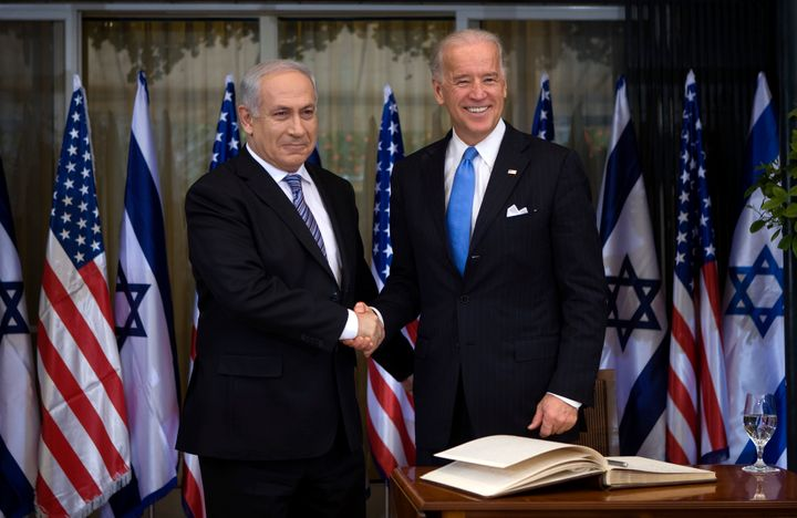 President Joe Biden, right, greets Israeli Prime Minister Benjamin Netanyahu in March 2010. Some U.S. foreign policy hands are skeptical that threatening to withhold aid will work this time.