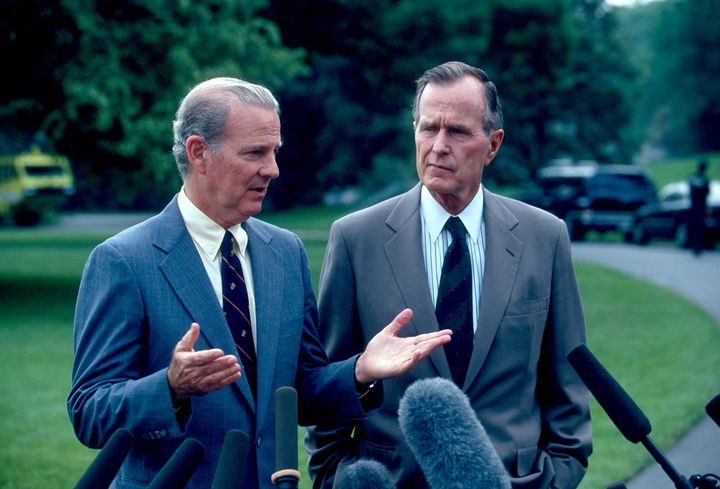 Secretary of State James A. Baker III and President George H.W. Bush speak to the press in May 1991. After the first Gulf War, Bush sought to achieve Palestinian-Israeli peace.