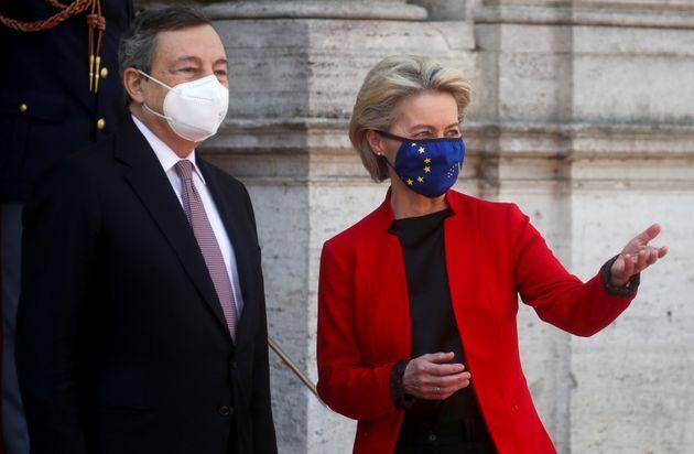 Italian Prime Minister Mario Draghi and European Commission President Ursula von der Leyen look on as...