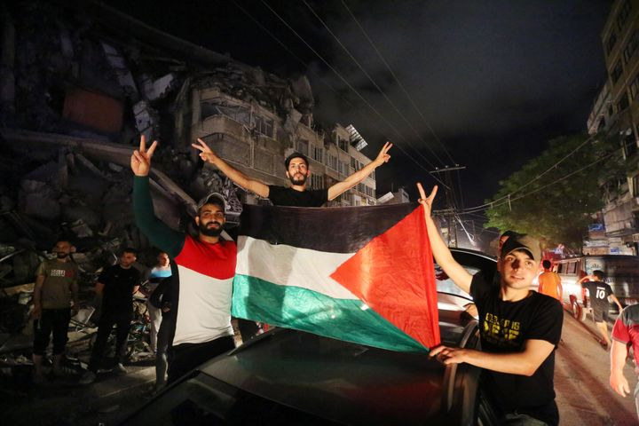 """Palestinians take the streets after """"mutual and simultaneous"""" cease-fire deal between Israel and Hamas reached with Egypt med"""