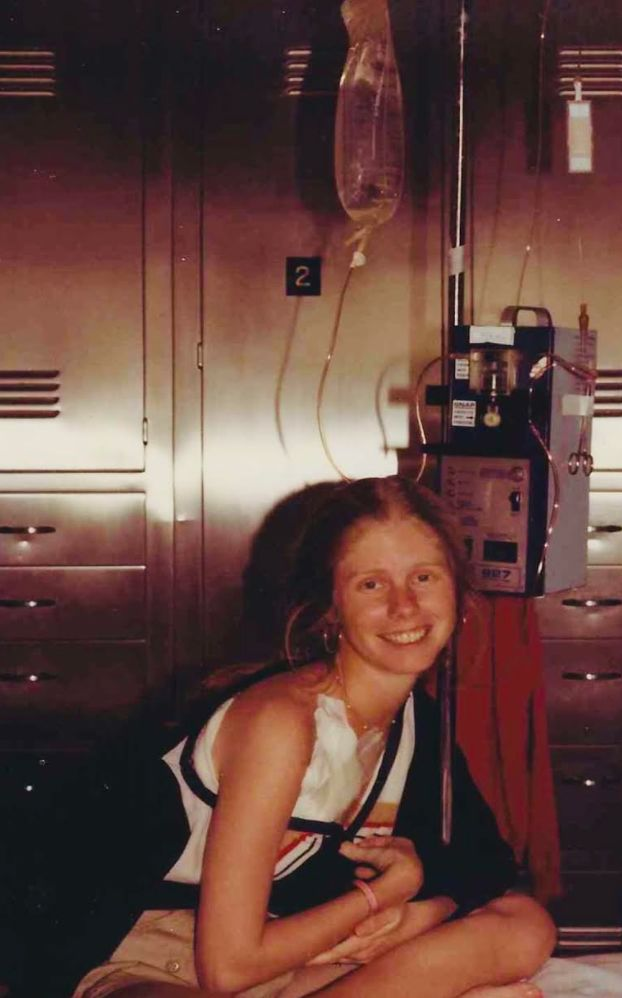 """The author, age 26, in the hospital for issues related to her Crohn's disease. """"At least the bathroom was accessible,"""" she jo"""