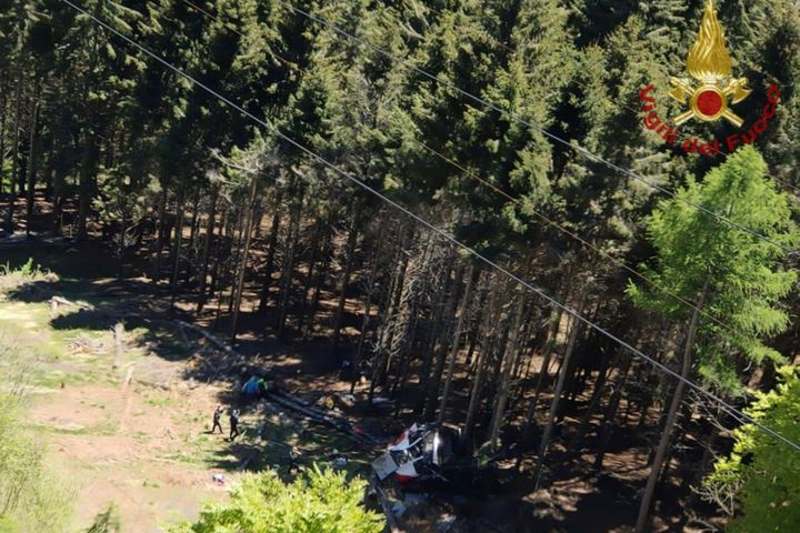 The wreckage of a cable car is seen on the ground after it collapsed near the summit of the Stresa-Mottarone line in the Pied