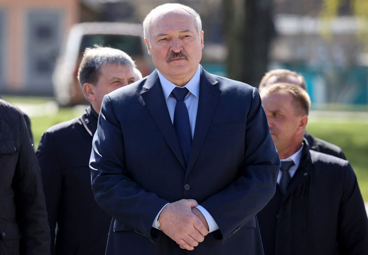 In this Monday April 26, 2021 file photo, Belarus President Alexander Lukashenko, accompanied by officials, attends a requiem
