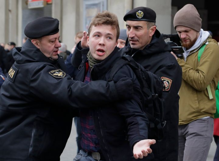 In this Sunday, March 26, 2017 file photo, Belarus police detain journalist Raman Pratasevich, center, in Minsk, Belarus. Ram