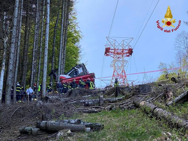 Italian fire fighters are seen near the crashed cable car after it fell from the Stresa-Alpine-Mottarone line near Lake Maggi