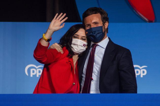 La candidata del PP a la Comunidad de Madrid, Isabel Díaz Ayuso, y el presidente del PP, Pablo...