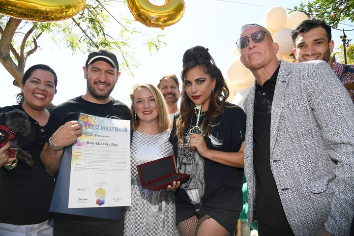 """West Hollywood Mayor Lindsey P. Horvath (third from left) and Lady Gaga pose on stage while celebrating """"Born This Way Day"""" o"""