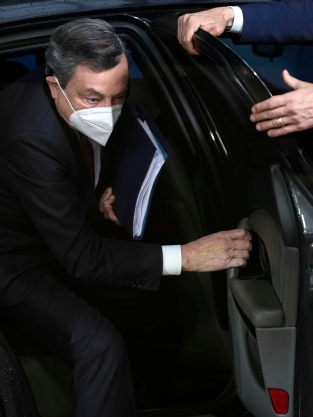epa09225508 Italy's Prime Minister Mario Draghi arrives for an EU summit at the European Council building...